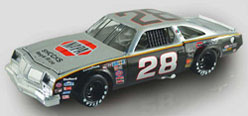 "2012 Buddy Baker 1977 ""Gray Ghost"" Napa Shocks 1:24 Diecast Car"